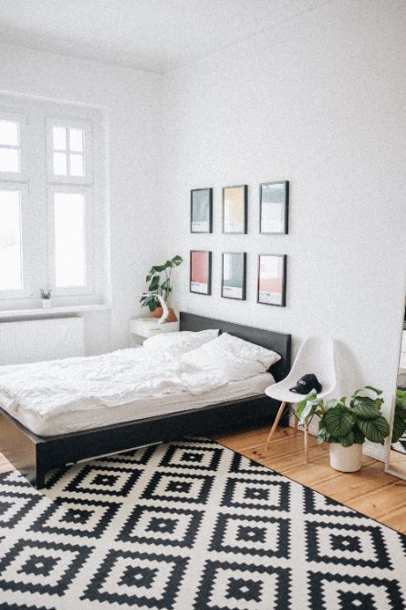 a well spread bed inside an apartment