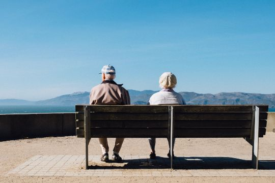 ensurity group, insurance agency, texas, united states, senior couple sit in the street looking at the mountains