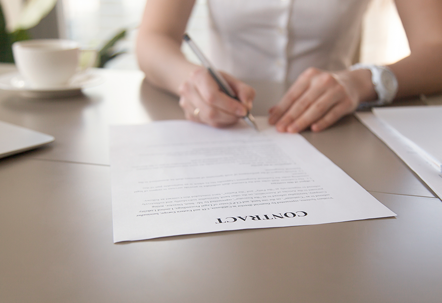 Female signing contract, picture to illustrate terms and conditions